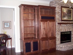"Notice the columns and lights in front of the bookcase.  The lights ""waah"" the front of the bookcase with this technique."