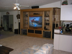 It is the focal point in a huge great room.  The facade in front of the TV is easily removed for access.