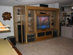 "The 62"" projection TV is great for daytime viewing.  Drawers at the bottom center are used for media storage."