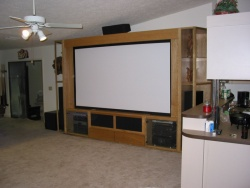 "And at nite the movies come alive with the motorized 110"" projection screen and 7.1 surround sound!"