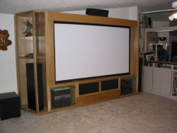 The TV's speakers can be heard through the grill cloth facade at the bottom of the screen.