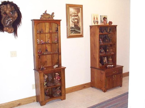 A couple pine display cabinets