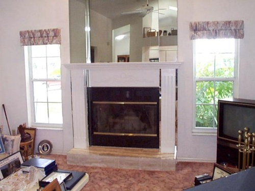 This wood mantel system was added to an existing mirrored fireplace---------------CLICK ON THE PICTURE TO SEE MORE PICTURES WITHIN THIS ALBUM